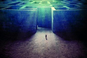 Tiny man entering a mysterious maze